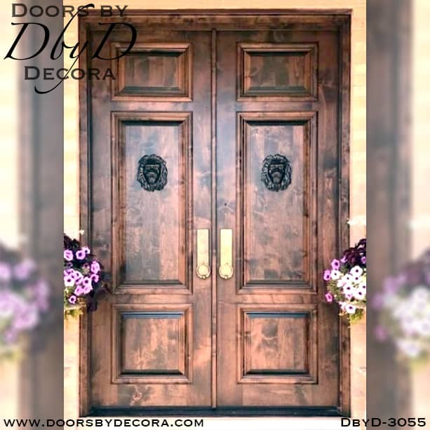 old world doors with lion heads