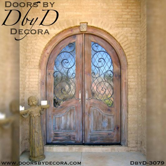 old world doors with glass and iron
