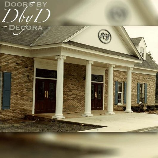 Double custom double doors grace the front of this bank.