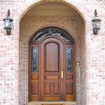 A beautiful leaded glass wrap around transom surrounds this eight foot tall solid door.