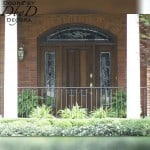 A solid door with leaded glass side lites and transom.