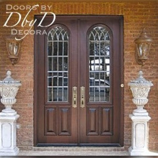 Double doors featuring leaded beveled glass.