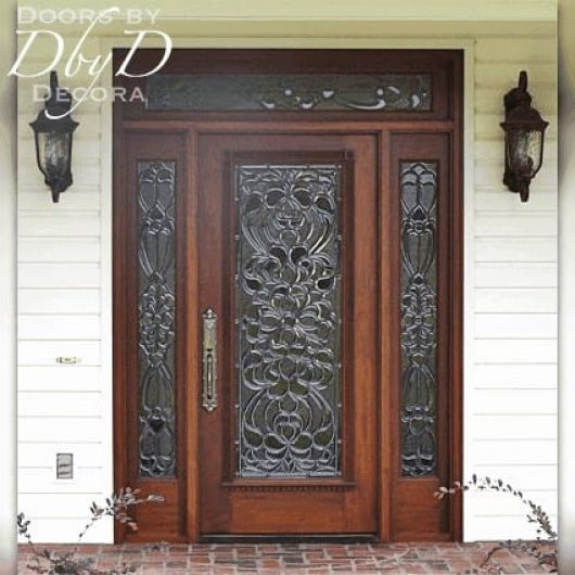 Standard full lite door, two side lites, and transom with custom leaded beveled glass.