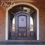 Segment top solid door with wrap around transom featuring beveled glass.