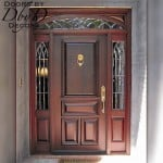 Standard solid door with our signature RET transom and custom leaded beveled glass.