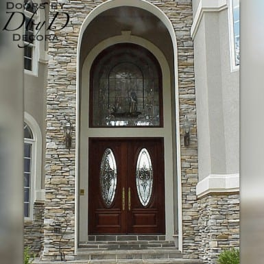 An interior shot of the custom transom and double doors designed and built by Doors by Decora.