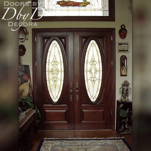 Double doors with leaded glass built to coordinate with our custom designed transom window.