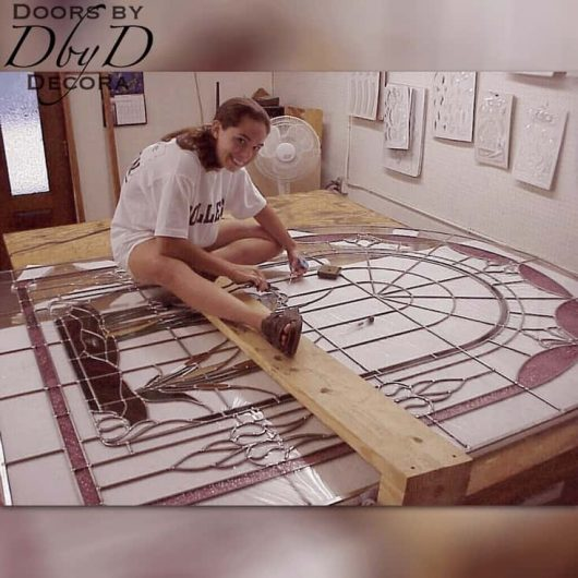 """An """"in progress"""" look at one of our employees building a custom leaded glass window."""