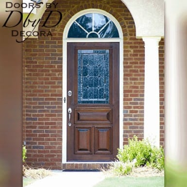 A simple leaded glass door with custom exterior molding.