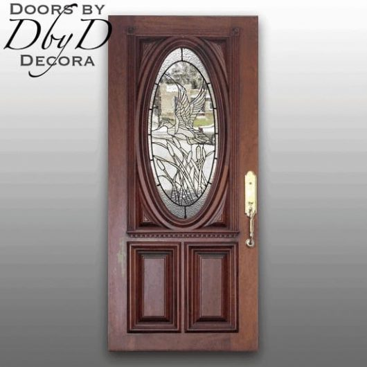 Our signautre oval door with custom leaded glass showing a duck in flight.