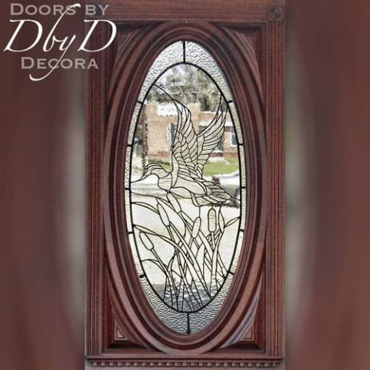 A close-up shot of our oval door with custom leaded glass.