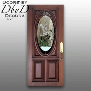 Our signature oval door with custom leaded stained glass featuring a duck in flight.