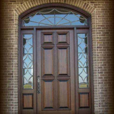 Our standard six panel door shown with leaded beveled glass side lites and transom.