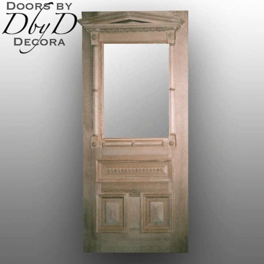 An unfinished door showing multiple examples of custom molding.