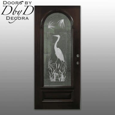 Leaded beveled and etched glass highlight this simple door.