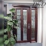 Simple two lite door with a side lite and stunning leaded beveled glass.