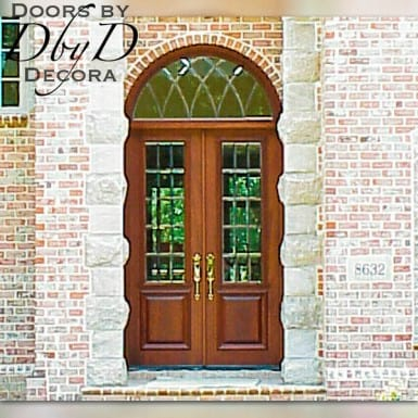 Double doors and a radius transom featuring leaded beveled glass.