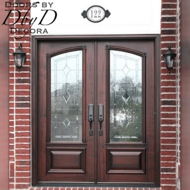 A close up shot of the custom double doors featuring custom leaded glass and door molding.