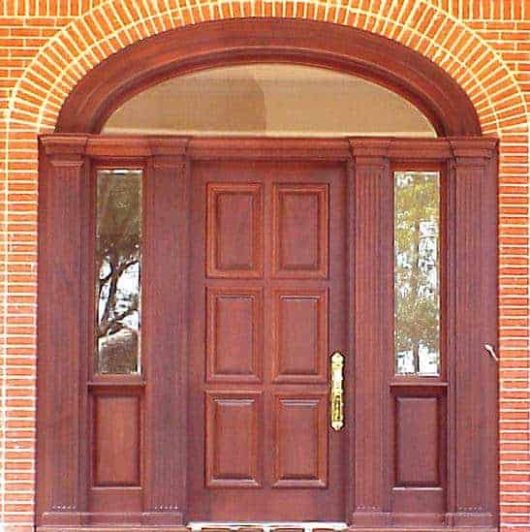 A finished photo showing the door, side lites, elliptical transom and custom jamb molding.