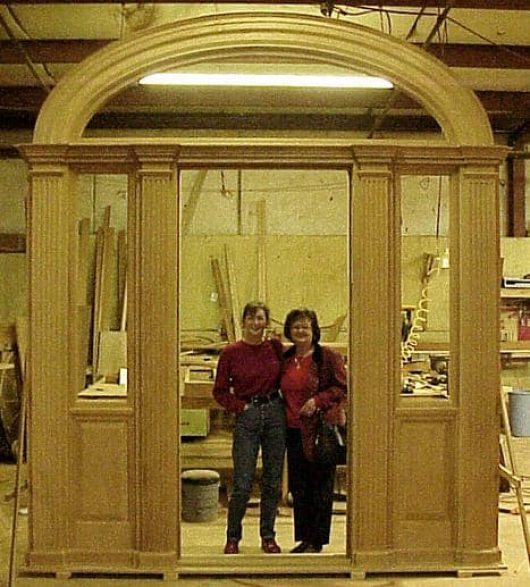 A photo of the home owner standing inside her unfinished jamb taken during the manufacturing process.