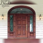 A unique eight panel door with custom side lites and an elliptical transom. This unit also features custom molding on the jamb.