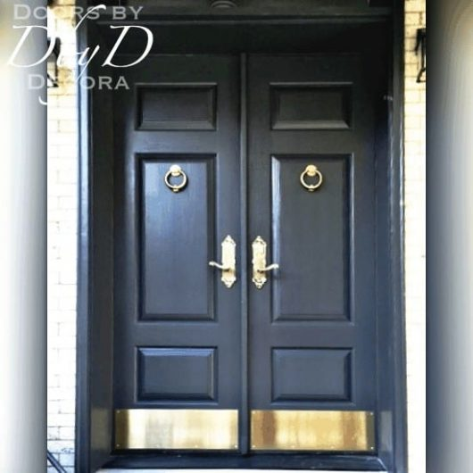 A beautiful pair of solid double doors with custom bottom rail to accommodate a large kick plate.