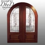 A pair of double radius top doors with custom leaded glass.
