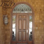 Our standard six panel door surrounded by two side lites and a radius transom with leaded beveled glass.