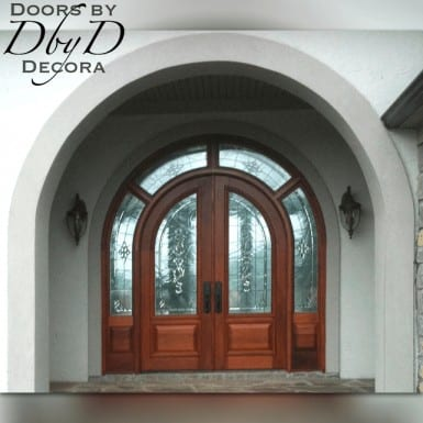 A pair of double radius top doors with a wrap around transom.
