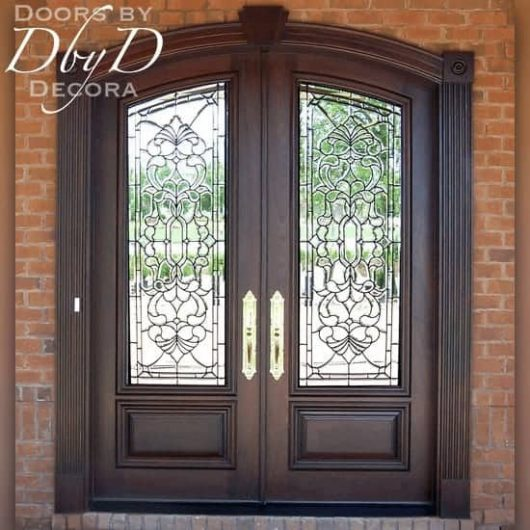 A beautiful pair of common segment top double doors with leaded beveled glass.