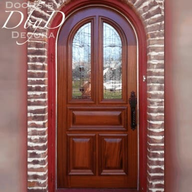This is a unique radius top door with leaded glass shown in place of the top two panels.