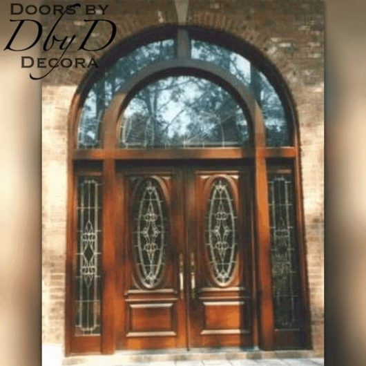 A grand entry showcasing double doors with two side lites and a custom double transom.
