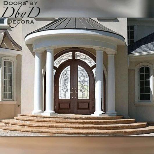 A beautiful pair of radius top doors with a custom wrap around transom.
