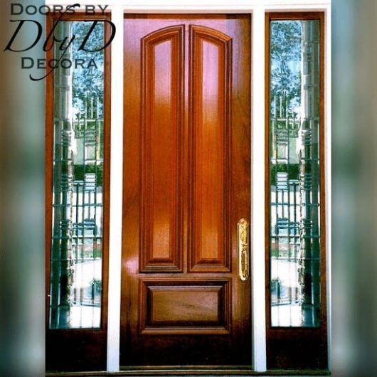 An eight foot tall door shown with contemporary leaded beveled side lites.