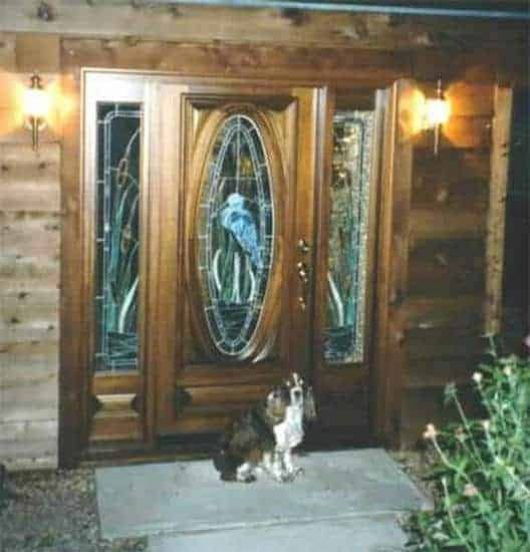 An exterior look at one of our oval doors with custom stained glass.