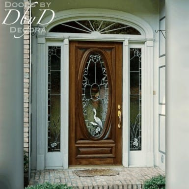 Our signature oval door shown with custom leaded glass in the door and side lites.