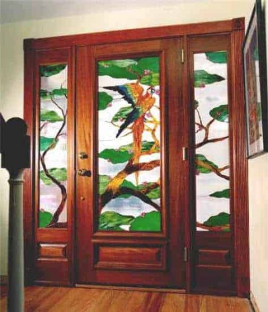 Custom stained glass inserts adorn this custom door.