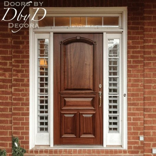 Solid wood door with custom architectural molding.