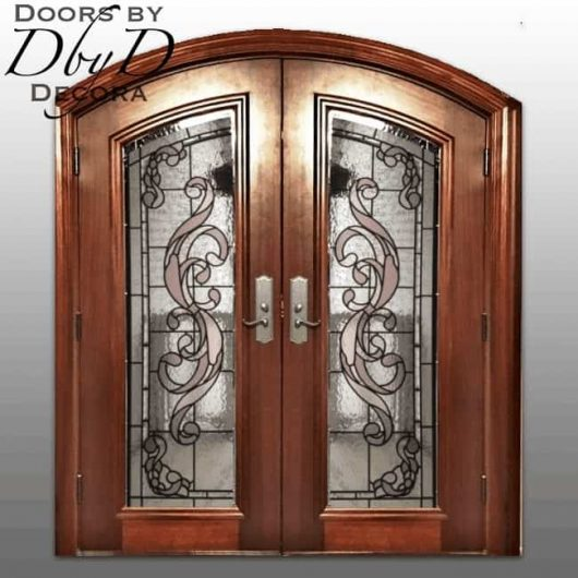 Double segment top doors with custom stained glass.