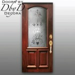 A traditional door featuring wheel engraved glass.