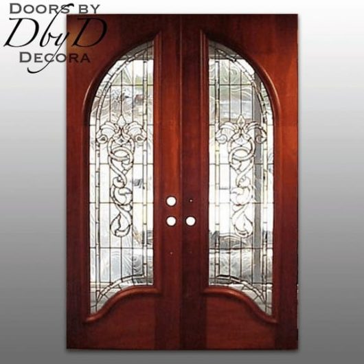 These double rectangular doors look arched because of their radius glass opening.