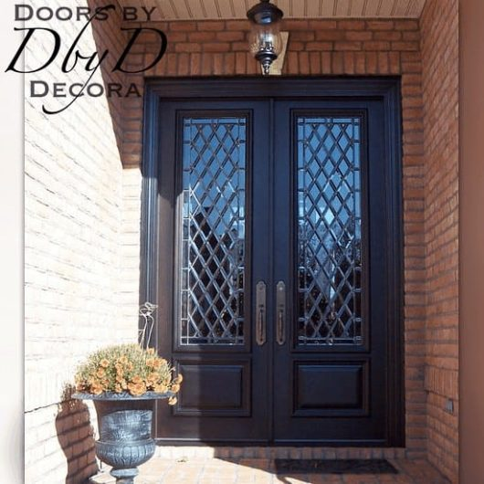 An elegant pair of double doors with leaded beveled glass.