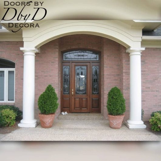 A wide shot of the traditional home featuring our custom front entry.