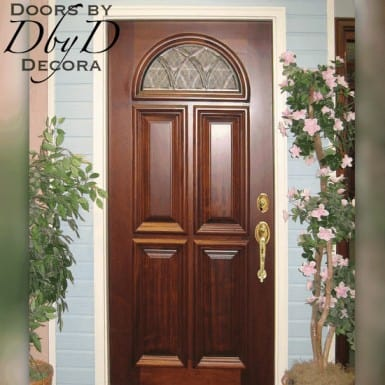 A beautiful wood door with a single leaded glass window in the top.