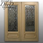 An unfinished pair of double doors with custom leaded beveled glass.