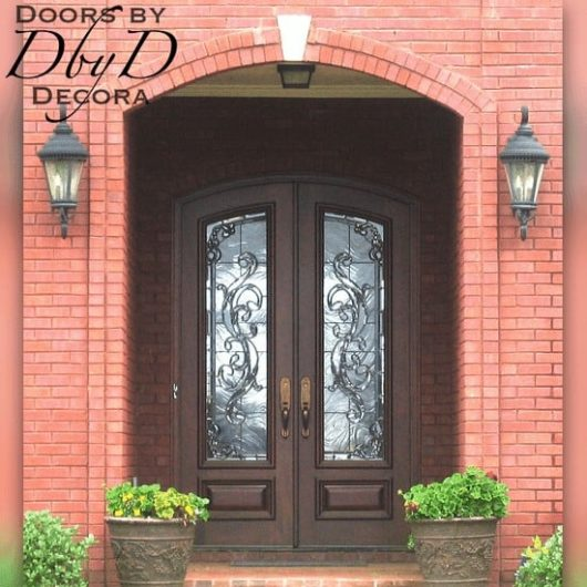 A beautiful pair of common segment top double doors with leaded glass.