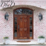 Solid six panel door with true divided light transom and side lites.