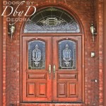 A beautiful pair of double doors with leaded glass and a matching radius transom.