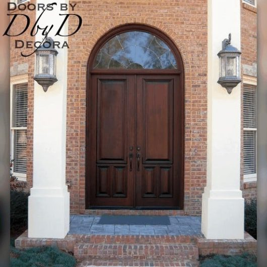 Eight foot tall double doors with a leaded glass transom.
