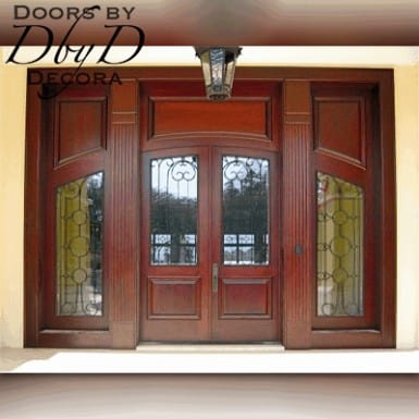 A custom door and jamb featuring wrought iron grills.